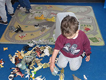photo of  boy in Dragonflies playing with dinosaurs at  Longscroft