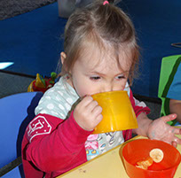 photo of a girl drinking at snack time in Dragonflies, Longscroft