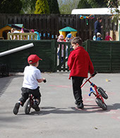 photo showing two boys playing with bikes at Longscroft
