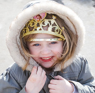 image of a girl in a gold crown on the Longscroft homepage
