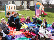 photo showing children at Longscroft playing outside