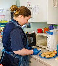 photo of staff in Bumble Bees preparing lunch at Longscroft