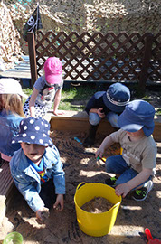 photo showing children playing in the sandpit at Longscroft